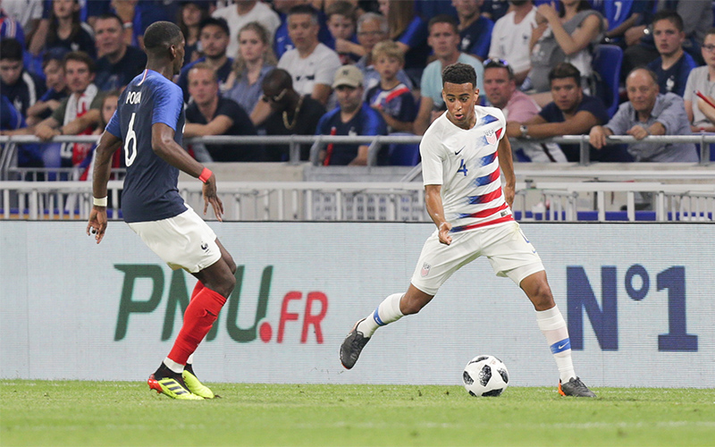 Tyler Adams on the dribble against Paul Pogba during the USA's 1-1 draw with France on June 9, 2018 in Lyon
