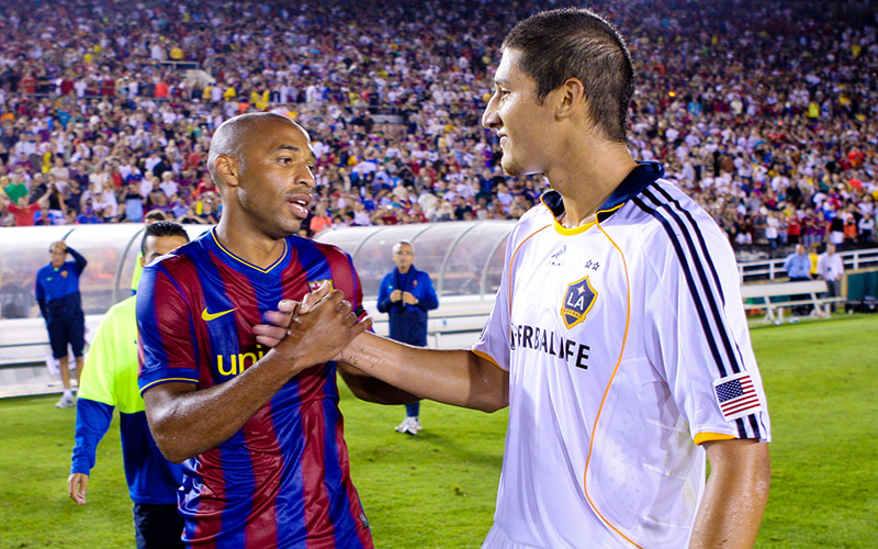 Omar Gonzalez shakes hands with Thierry Henry after a friendly vs. FC Barcelona in 2009
