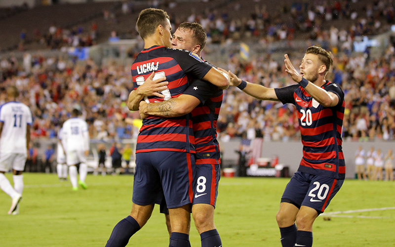 Jordan Morris celebrates his first goal vs. Martinique with U.S. MNT defender Eric Lichaj and Paul Arriola (John Dorton / ISI Photos)