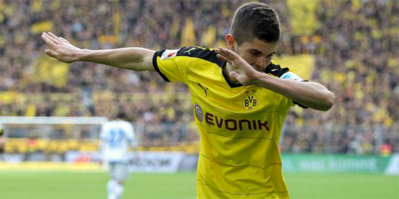 U.S. Men's National Team midfielder Christian Pulisic celebrates his first goal for Borussia Dortmund on April 17, 2016 vs. Hamburg.
